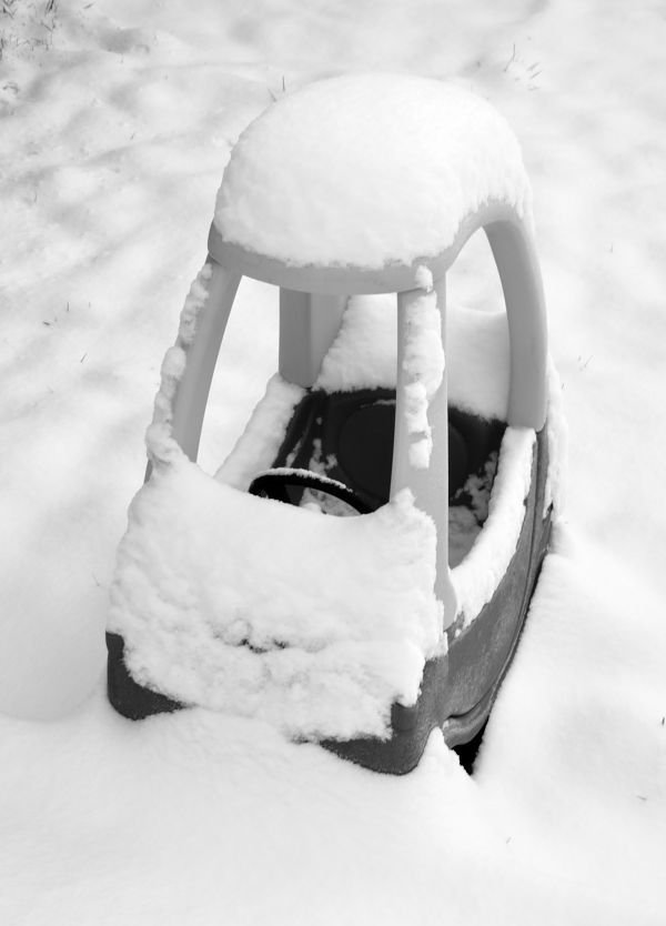 child's car in the snow