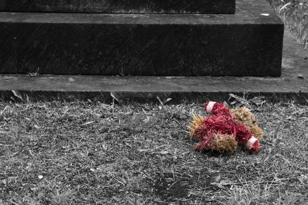 Straw teddy discarded at Undercliffe Cemetery