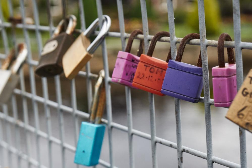 Many coloured padlocks on the Wharfe Bridge at Otley