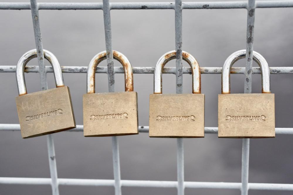 four padlocks in a row on the Wharfe Bridge at Otley