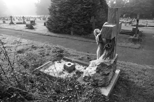 Woman at Cross gravestone