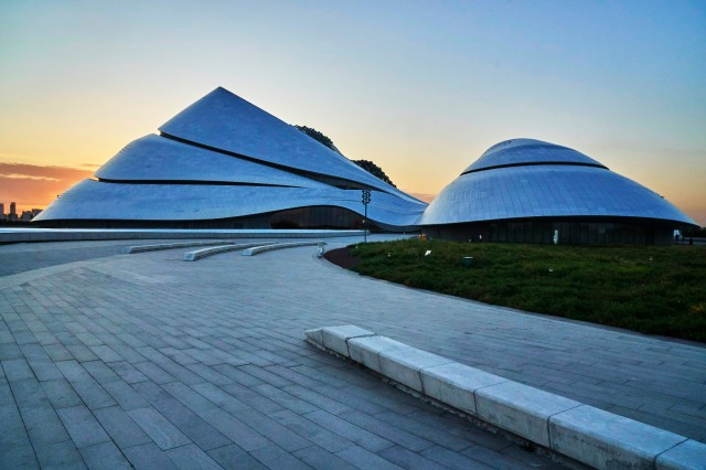 Sunset behind Harbin Grand Theatre